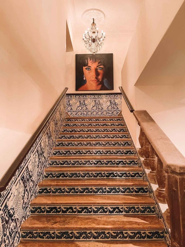 stair case with elizabeth taylor painting at the top at casa kimberly in puerto vallarta, mexico