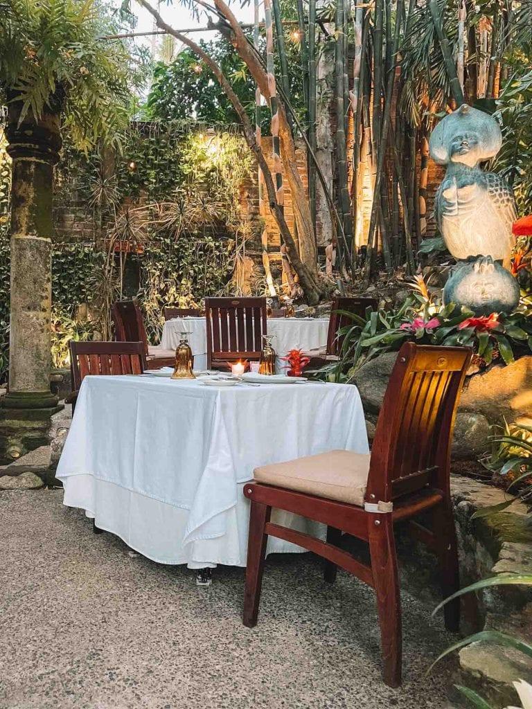 garden dining set up at cafe des artistes in puerto vallarta, mexico