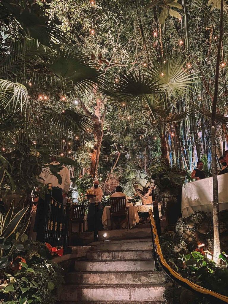 garden area at Cafe Des Artistes in puerto vallarta, mexico