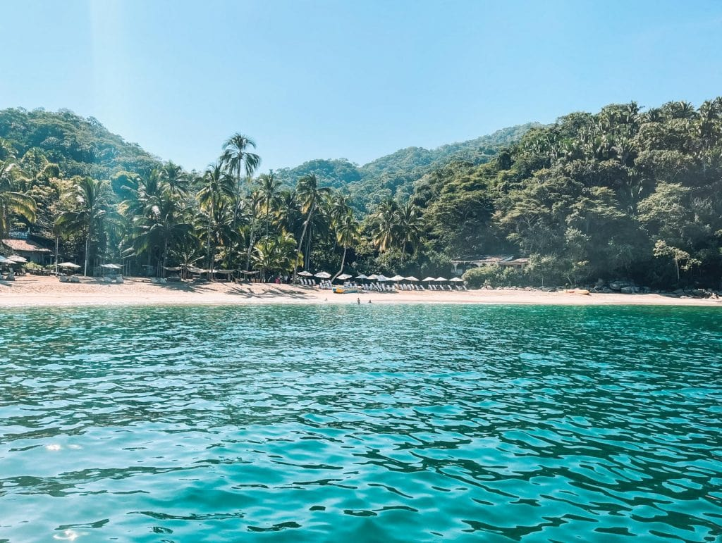 view of Majahuitas Beach from the boat, one of many hidden beaches in puerto vallarta