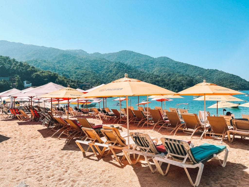 beach lounge chairs available in front of Fanny's in Yelapa, Mexico