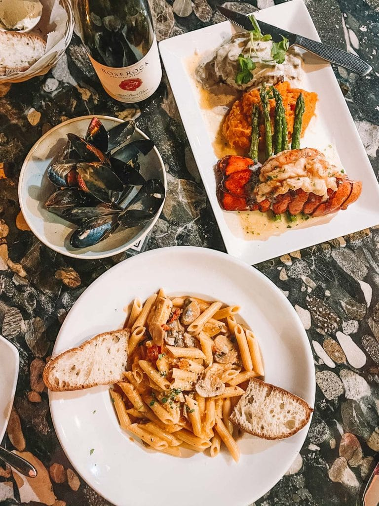 lobster, steak, chicken penne and mussels at clara in carlsbad california