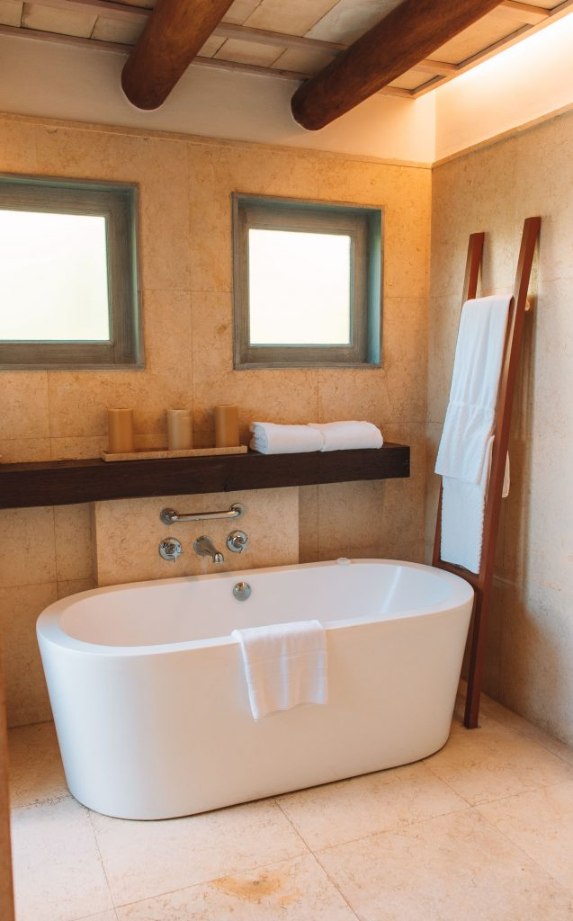marble tub and ladder with towels at st regis punta mita mexico