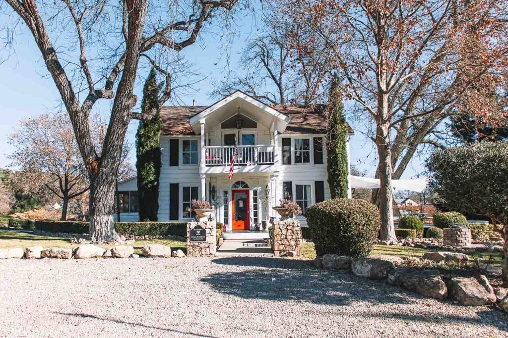 farmhouse inn with red door at hammer sky vineyards and winery in paso robles california