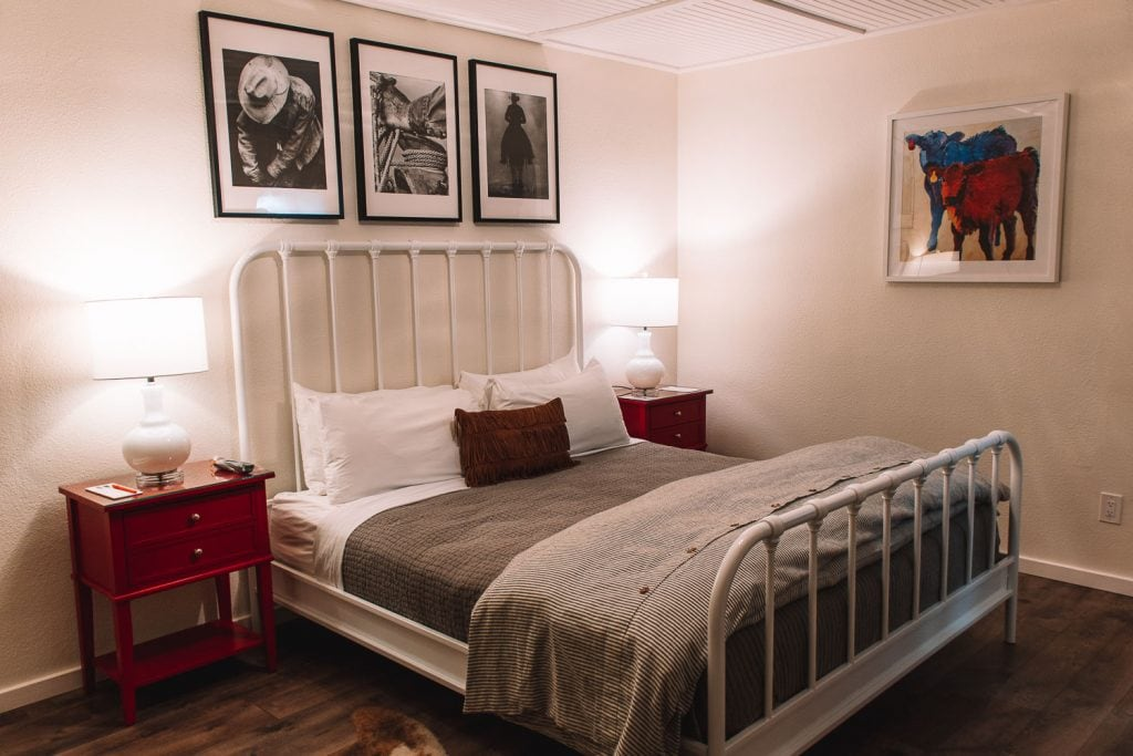 white framed bed and cowboy pictures at the stables inn in paso robles california