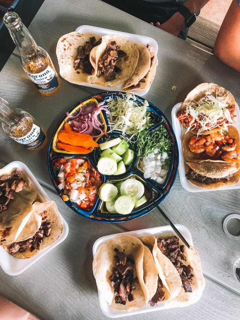 tacos and toppings at tacos guss in cabo san lucas mexico