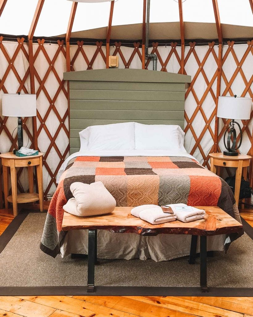 queen bed provided in glamping yurt at treebones resort big sur