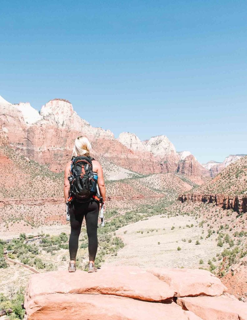 blonde girl hiking the watchman trail in zion national park