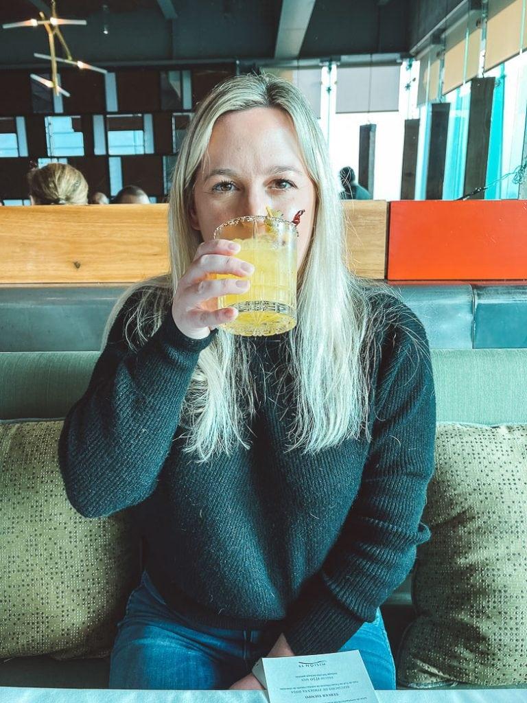 blonde girl drinking a margarita